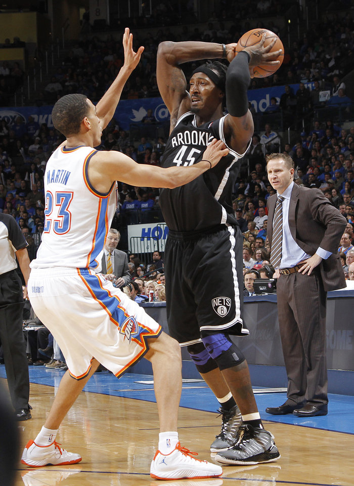 Photo - Oklahoma City's Kevin Martin (23) defends on Brooklyn Nets' Gerald Wallace (45) during the NBA basketball game between the Oklahoma City Thunder and the Brooklyn Nets at the Chesapeake Energy Arena on Wednesday, Jan. 2, 2013, in Oklahoma City, Okla. Photo by Chris Landsberger, The Oklahoman
