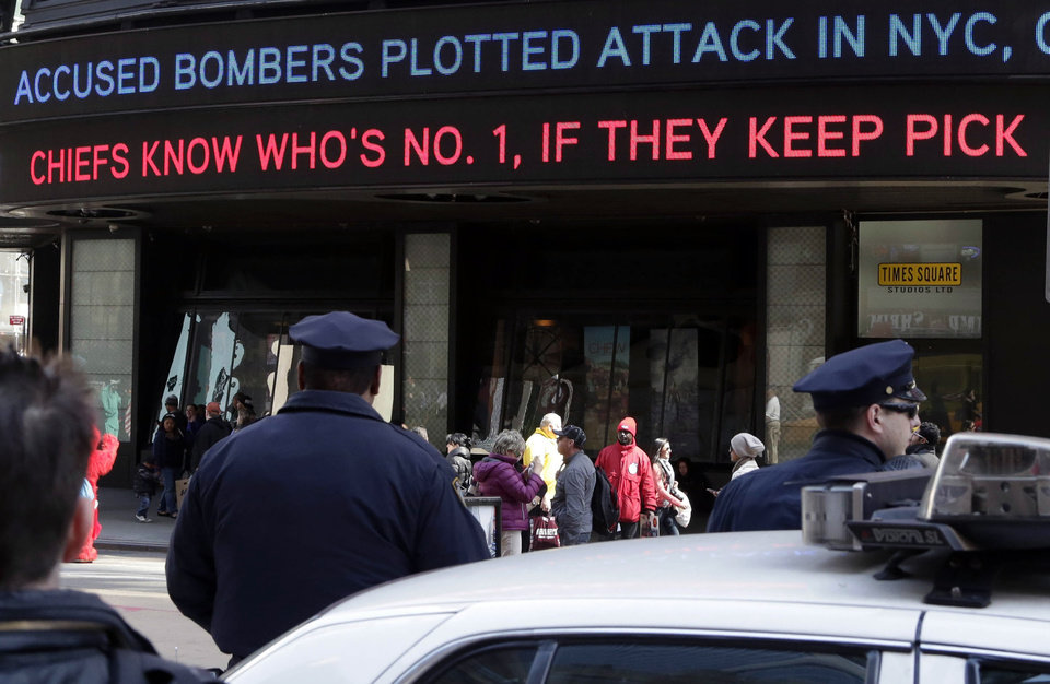 Photo - News headlines circle a building in New York's Times Square,  Thursday, April 25, 2013. The Boston Marathon bombing suspects had planned to blow up their remaining explosives in New York's Times Square, officials said Thursday. (AP Photo/Richard Drew)