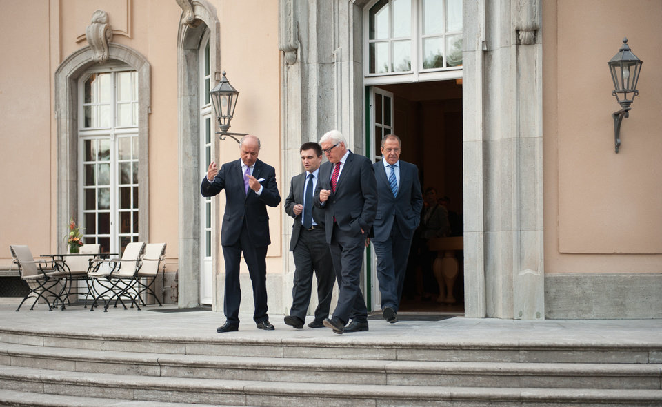 Photo - The Foreign Ministers of France Laurent Fabius, Ukraine Pavlo Klimkin Germany Frank-Walter Steinmeier, and Russia Sergey Lavrov, from left, go for a walk before a meeting at the Guesthouse of Foreign Ministry Villa Borsig in Berlin, Sunday, Aug. 17, 2014. (AP Photo/Steffi Loos)