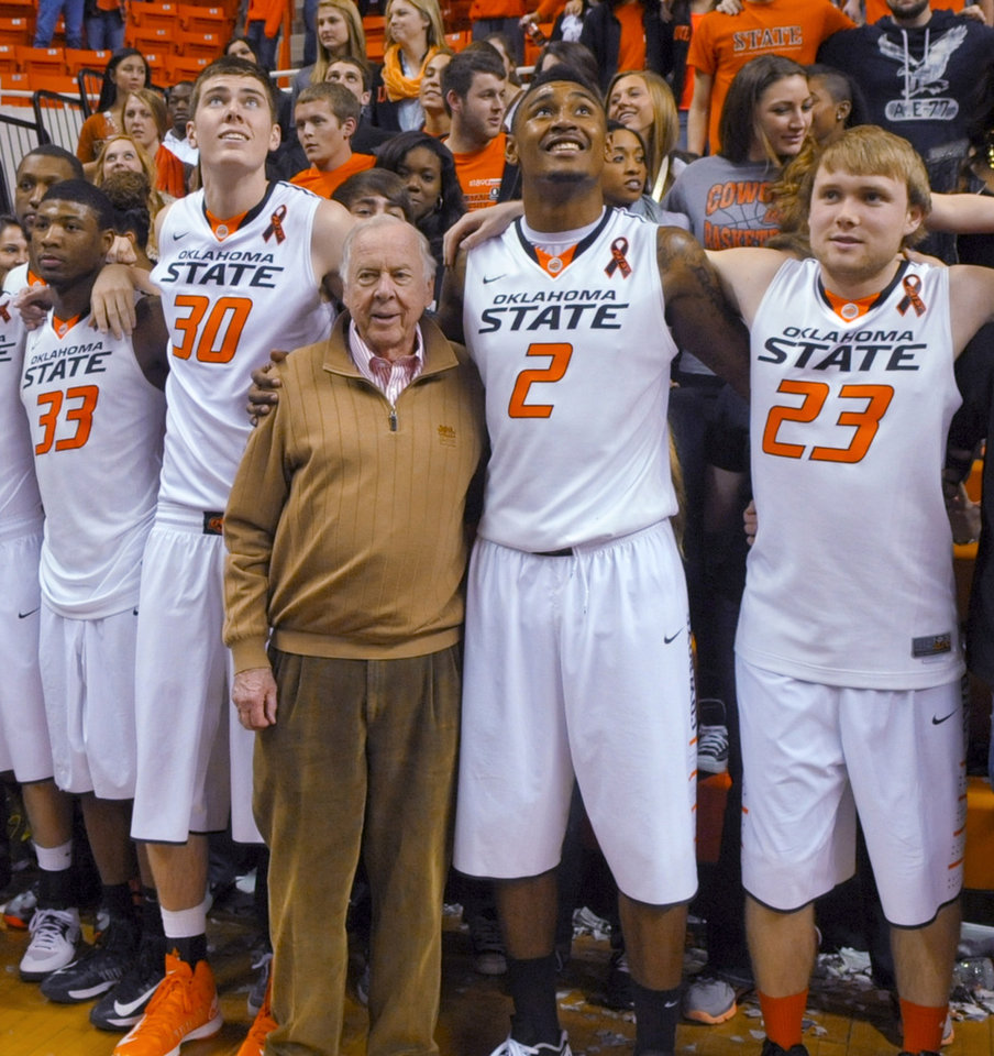 Oil tycoon and Oklahoma State suppoerter T. Boone Pickens, center, celebrates with Oklahoma State's basketball team members Marcus Smart (33), Mason Cox (30), Le'Bryan Nash (2) and Alex Budke, right,  following the team's 78-65 win over Texas in an NCAA college basketball game in Stillwater, Okla., Saturday, March 2, 2013. (AP Photo/Brody Schmidt)