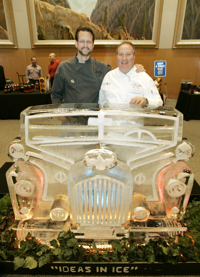 Chefs' Kurt Fleischfresser with the Coach House and Don Thiery pose with an ice sculpture by Ken Burkemper at the National Cowboy & Western Heritage Museum in Oklahoma City, April  12, 2007.  Oklahoman Photo By  Steve Gooch