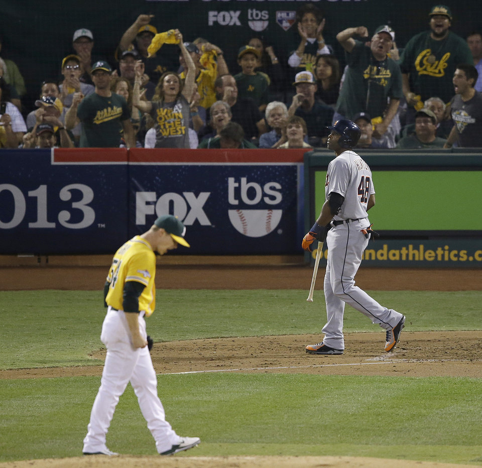 Detroit Tigers' Torii Hunter, right, walks to the dugout after striking out against Oakland Athletics starting pitcher Sonny Gray, left, during the third inning of Game 2 of an American League baseball division series in Oakland, Calif., Saturday, Oct. 5, 2013. (AP Photo/Jeff Chiu)