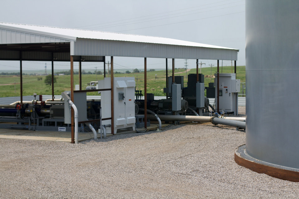 Tanks and equipment at Chaparral Energy's North Burbank field in Osage County separate oil, water and carbon dioxide from produced wells. The oil is then sold, while the water and carbon dioxide are reinjected into the rock formations to further stimulate production. <strong>photo by Adam Wilmoth</strong>