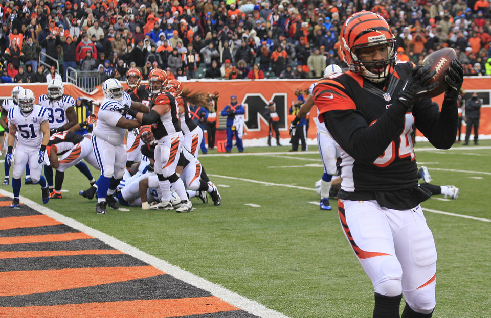 Photo - Cincinnati Bengals tight end Jermaine Gresham (84) catches a 1-yard touchdown pass against the Indianapolis Colts in the second half of an NFL football game, Sunday, Dec. 8, 2013, in Cincinnati. (AP Photo/Tom Uhlman)