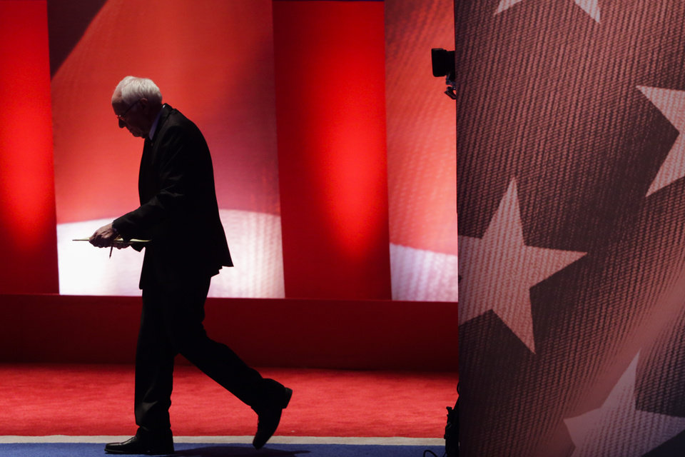Photo - Democratic presidential candidate, Sen. Bernie Sanders, I-Vt,  walks back on stage after a break during a Democratic presidential primary debate with Democratic presidential candidate, Hillary Clinton hosted by MSNBC at the University of New Hampshire Thursday, Feb. 4, 2016, in Durham, N.H. (AP Photo/David Goldman)