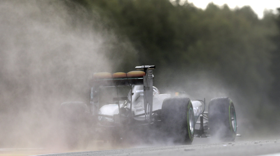 Photo - Mercedes driver Lewis Hamilton of Britain  steers his car during the qualifying session at the Spa-Francorchamps circuit, Belgium, Saturday, Aug. 23, 2014. The Belgium Formula One Grand Prix will be held on Sunday. (AP Photo/Luca Bruno)