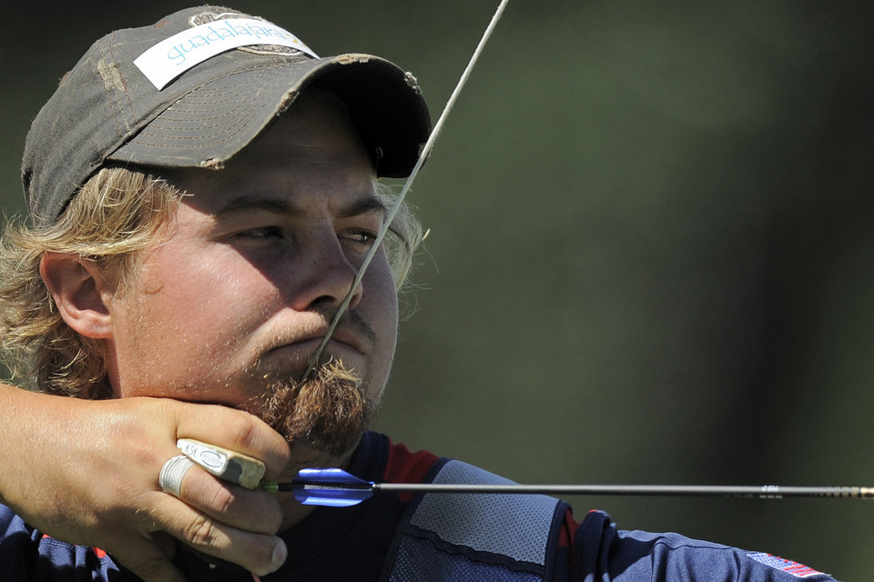 """Photo -   FILE -- This Oct. 22, 2011 file photo shows Brady Ellison, of the United States, aiming during the men's individual archery competition at the Pan American Games in Guadalajara, Mexico. """"The Hunger Games"""" has shined a bright light on the ancient sport of archery and fueled interest across the country to pick up a bow and arrow. A strong performance by U.S. men and women in London also could bolster the sport's growing popularity, said Ellison, currently No. 1 in the world and viewed as the team's best shot for a gold medal. (AP Photo/Daniel Ochoa de Olza, File)"""