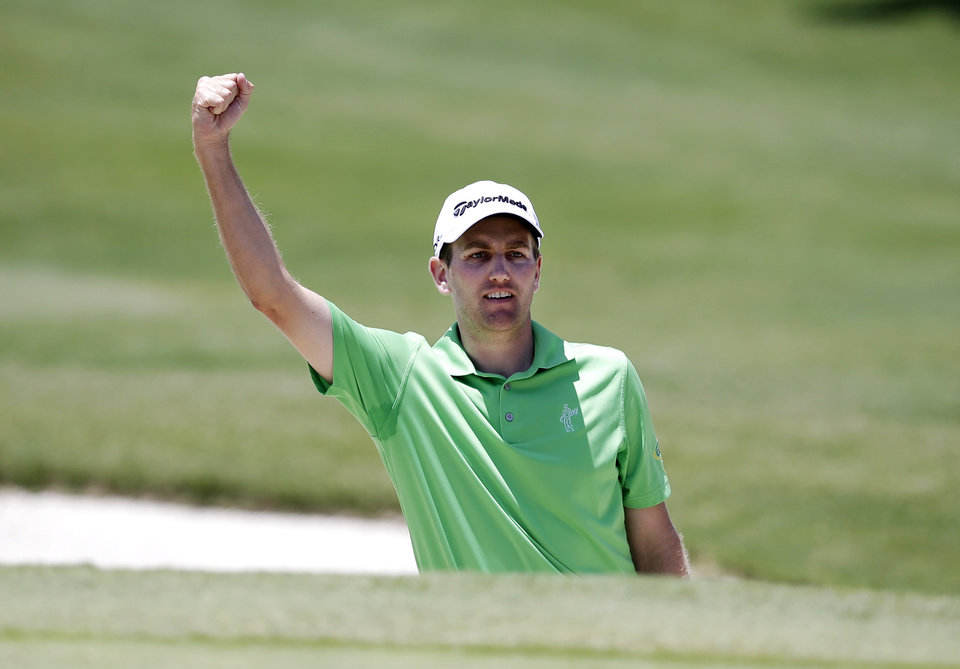 Photo - Brendon Todd pumps his fist after holing out of a bunker for birdie on the second green during the final round of the Byron Nelson Championship golf tournament, Sunday, May 18, 2014, in Irving, Texas. (AP Photo/Tony Gutierrez)