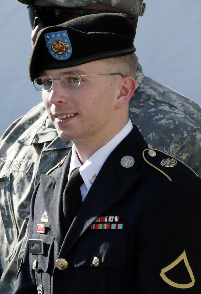 FILE - In this June 25, 2012 file photo, Army Pfc. Bradley Manning is escorted out of a courthouse in Fort Meade, Md., after a pretrial hearing.  A military judge hears closing arguments on Tuesday, Dec. 12, 2012, on whether Manning who is charged with sending classified material to WikiLeaks, suffered illegal pretrial punishment during nine months in a Marine Corps brig. Army Pfc. Bradley Manning's lawyers claim his treatment was so egregious that all charges should be dismissed. (AP Photo/Patrick Semansky, HO)