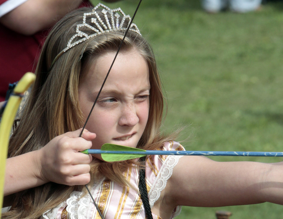 Emily Stoermey, 9, from Altus, takes aim at an archery target durig Medieval Fair on Friday, March 30, 2012, in Norman, Okla.  Photo by Steve Sisney, The Oklahoman