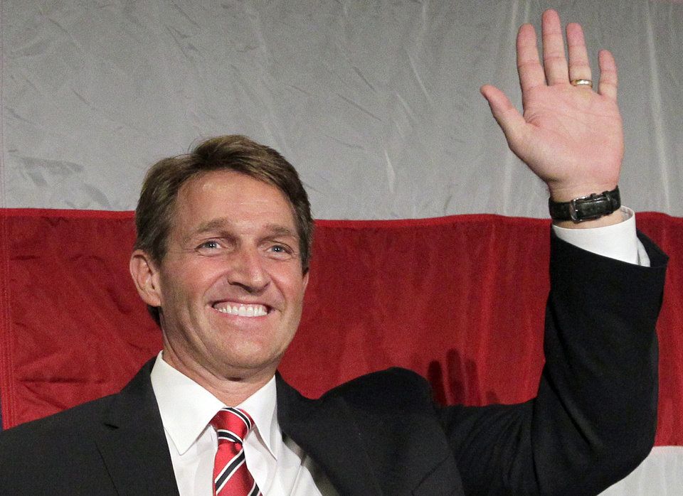 Photo -   FILE - In this Nov. 6, 2012 file photo, Sen.-elect, current Rep. Jeff Flake, R-Ariz., waves during an election night party in Phoenix. (AP Photo/Matt York, File)