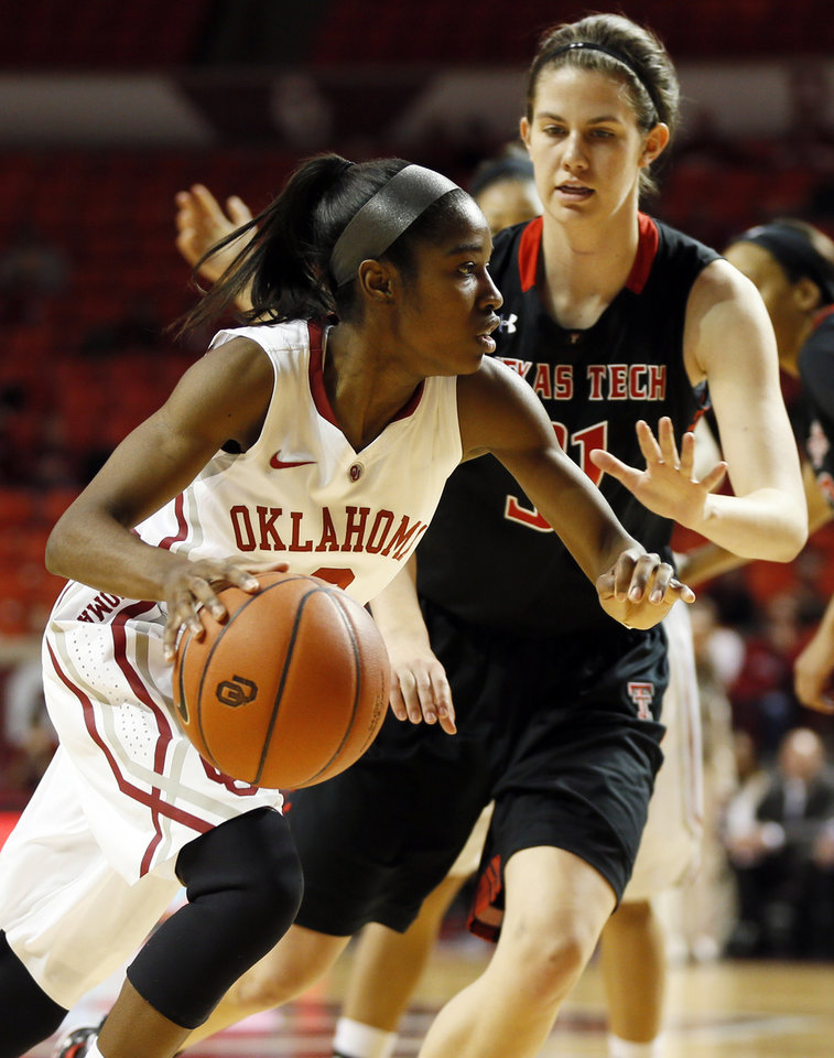 Photo - Oklahoma's Aaryn Ellenberg (3) drives against Texas Tech's Haley Schneider (31) during a women's college basketball game between the Oklahoma Sooners and Texas Tech at Lloyd Noble Center in Norman, Okla., Monday, March 3, 2014. OU won 87-32. Photo by Nate Billings, The Oklahoman