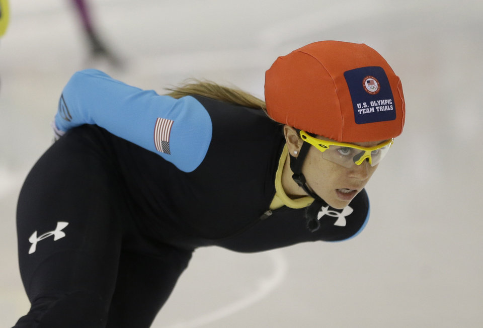 Photo - Jessica Smith competes in the women's 1,500 meters during the U.S. Olympic short track trials Friday, Jan. 3, 2014, in Kearns, Utah. (AP Photo/Rick Bowmer)