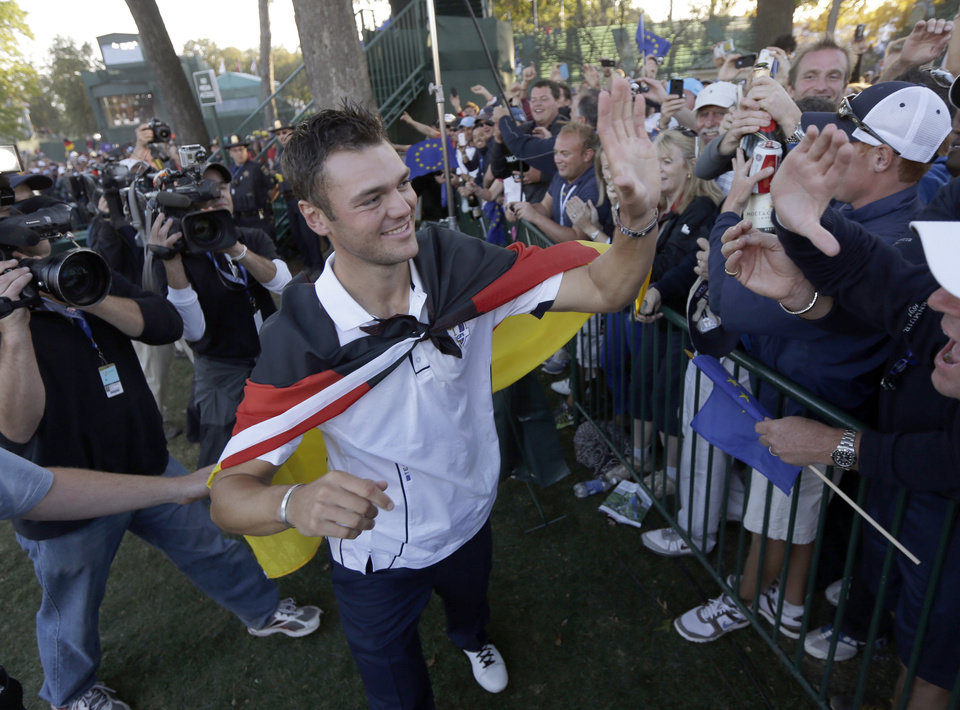 Photo - Europe's Martin Kaymer celebrates after winning the Ryder Cup PGA golf tournament Sunday, Sept. 30, 2012, at the Medinah Country Club in Medinah, Ill. (AP Photo/David J. Phillip)  ORG XMIT: PGA232