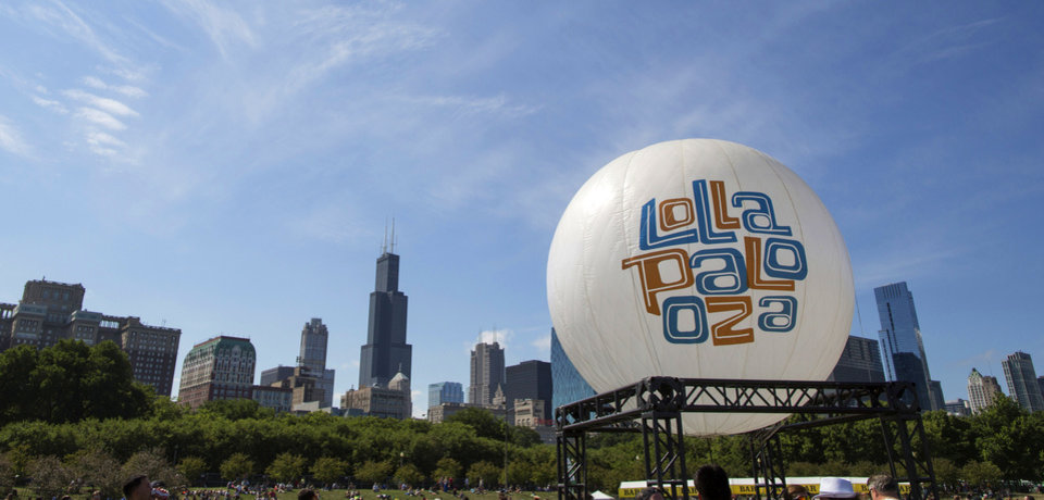 Photo - FILE - This Aug. 4, 2013 file photo shows a Lollapalooza balloon at the Lollapalooza Festival in Grant Park in Chicago. Lollapalooza marks its 10th anniversary in Chicago when it opens for three days starting Friday,  Aug. 1, 2014, with a lineup including Eminem, Outkast and Kings of Leon. Lollapalooza became the basis for the modern festival culture and circuit that has evolved since, including events like Bonnaroo, Coachella and a legion of smaller multi-day parties. (AP Photo/Scott Eisen, File)