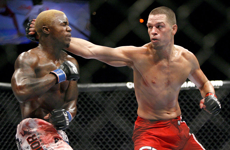 Photo - MIXED MARTIAL ARTS / MMA: Melvin Guillard, left, fights Nate Diaz during UFC Fight Night at the Cox Convention Center in Oklahoma City, Wednesday, September 16, 2009.  Photo by Bryan Terry, The Oklahoman ORG XMIT: KOD