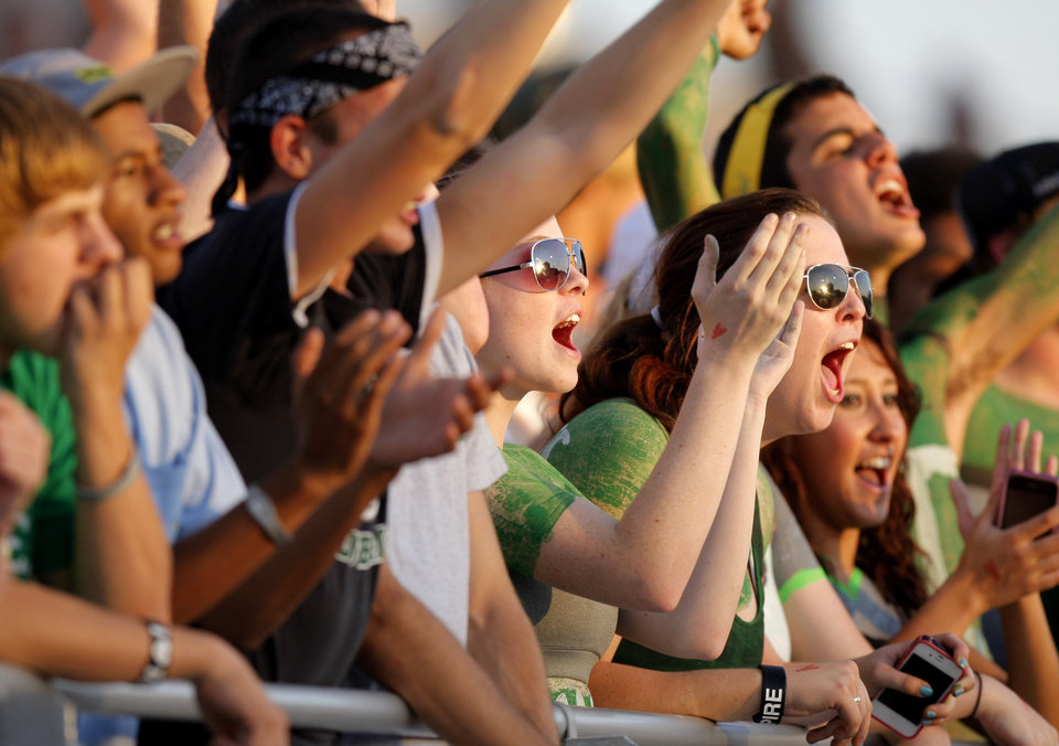 Photo - Edmond Santa Fe fans cheer during a high school football game against Yukon Fe in Yukon, Okla., Friday, Sept. 9, 2011. Photo by Bryan Terry, The Oklahoman
