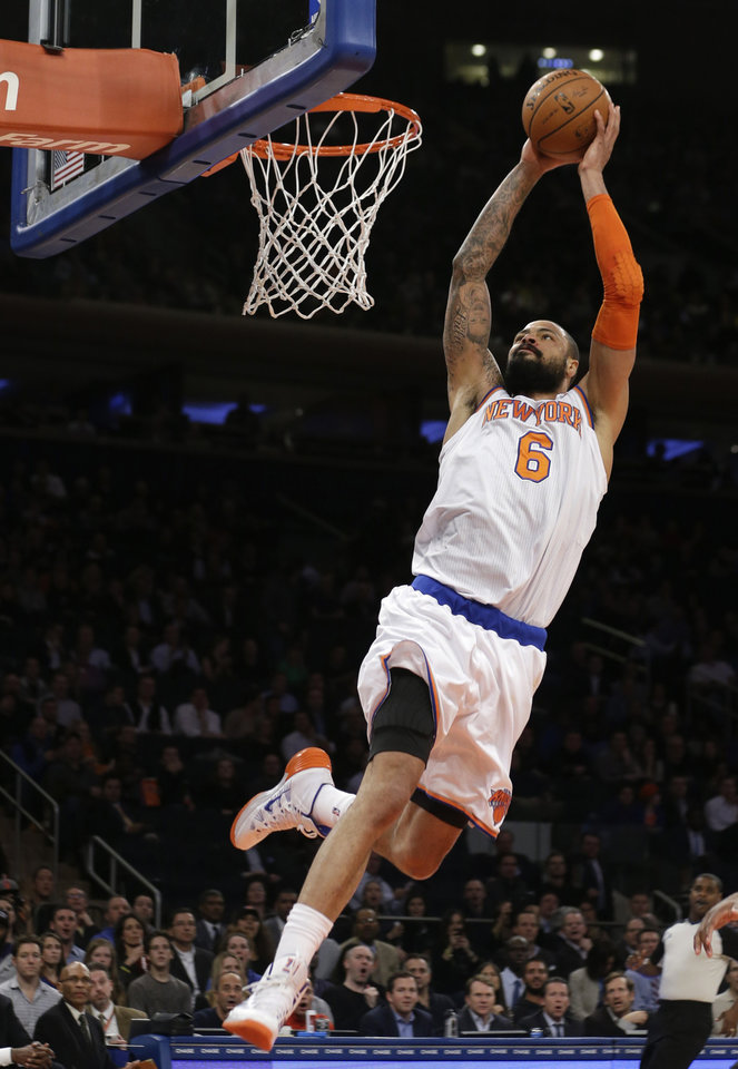 Photo - New York Knicks' Tyson Chandler (6) dunks the ball during the first half of an NBA basketball game against the Sacramento Kings on Wednesday, Feb. 12, 2014, in New York.  (AP Photo/Frank Franklin II)