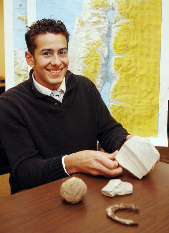 Photo - Herbert W. Armstrong College student Jeremy Cocomise, who went on archeological dig in Israel, demonstrates some of the artifacts brought back to the college in Edmond, OK, Monday, Dec. 15, 2008. BY PAUL HELLSTERN, THE OKLAHOMAN ORG XMIT: KOD
