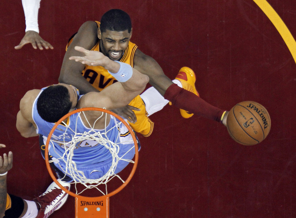 Cleveland Cavaliers' Kyrie Irving shoots over Denver Nuggets' JaVale McGee in the first quarter of an NBA basketball game Saturday, Feb. 9, 2013, in Cleveland. (AP Photo/Mark Duncan)