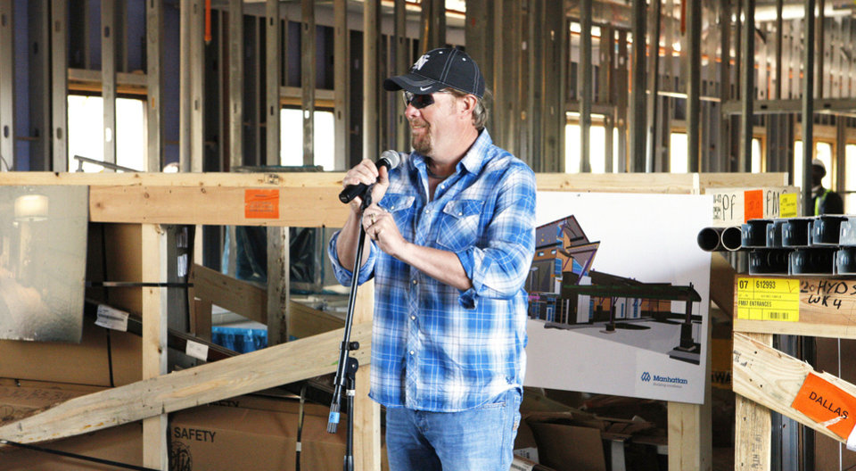 Toby Keith speaks to construction workers at the OK Kids Korral, 818 NE 8, under construction in Oklahoma City. Photos by Paul B. Southerland, The Oklahoman
