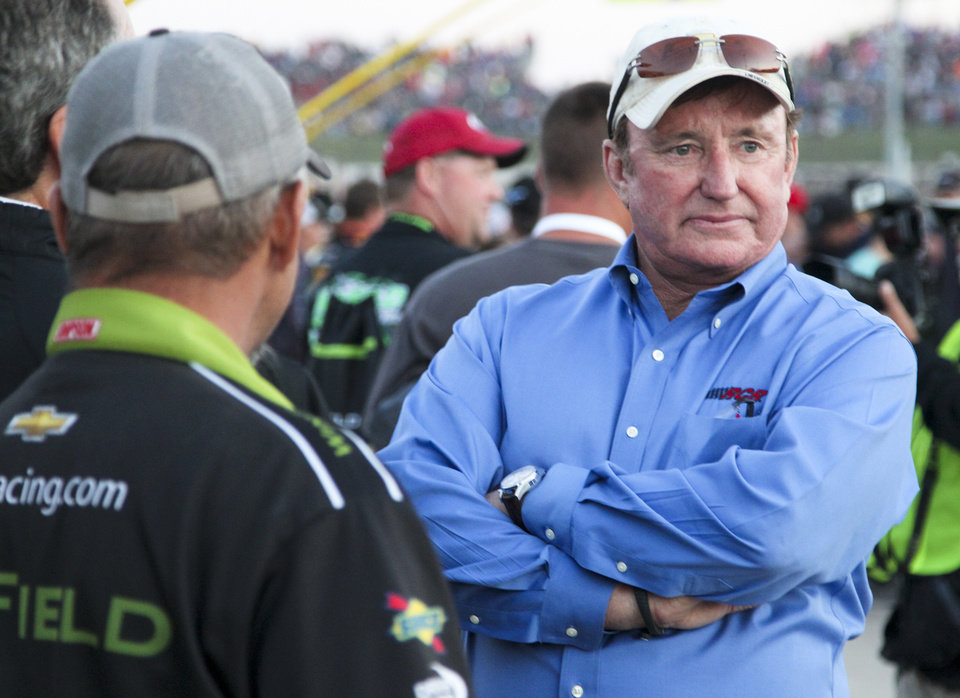 Photo - Richard Childress of Childress Racing watches from pit lane before the NASCAR Truck Series auto race Wednesday, July 24, 2013, on the dirt at Eldora Speedway in Rossburg, Ohio. (AP Photo/Dayton Daily News, Greg Lynch) LOCAL PRINT OUT AND LOCAL TV OUT (WKEF, WRGT, WDTN)