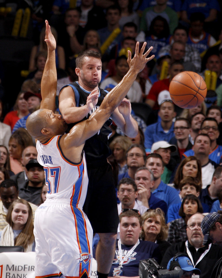 Photo - Oklahoma City's Derek Fisher (37) defends Minnesota's Jose Juan Barea (11) during the NBA basketball game between the Oklahoma City Thunder and the Minnesota Timberwolves at Chesapeake Energy Arena in Oklahoma City, Friday, March 23, 2012. Photo by Bryan Terry, The Oklahoman