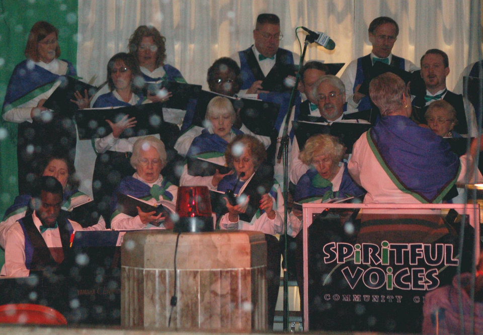 "Let it snow!  Audiences at Oklahoma City's Opening Night 2007 were treated to an indoor ""snowfall"" at First National Center's second floor lobby while Spiritful Voices Community Choir sang ""Let It Snow/Winter Wonderland.""<br/><b>Community Photo By:</b> Robin Wilmoth<br/><b>Submitted By:</b> Sam P., Oklahoma City"