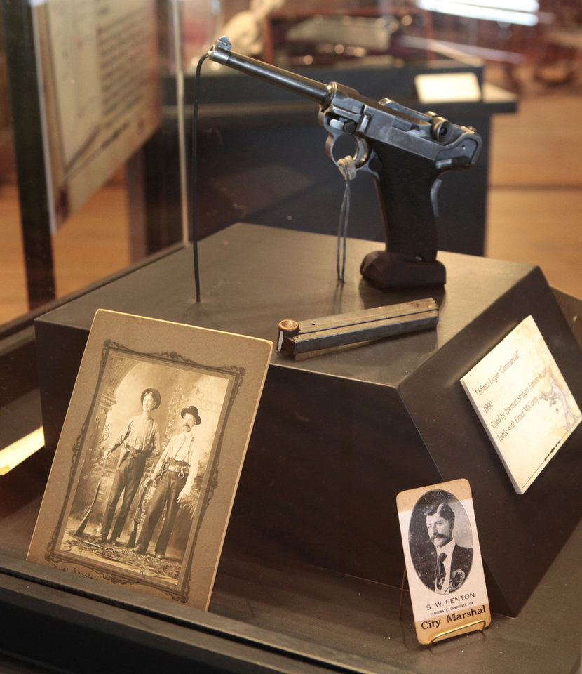 Photo - The Luger used by lawman Stringer Fenton in the gun battle with Elmer McCurdy is on display in the Guthrie exhibit. Photo by David McDaniel, The Oklahoman  David McDaniel - The Oklahoman