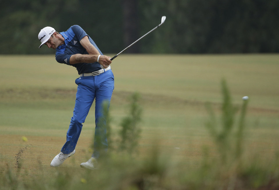 Photo - Dustin Johnson hits from the fairway on the 10th hole during the second round of the U.S. Open golf tournament in Pinehurst, N.C., Friday, June 13, 2014. (AP Photo/Chuck Burton)