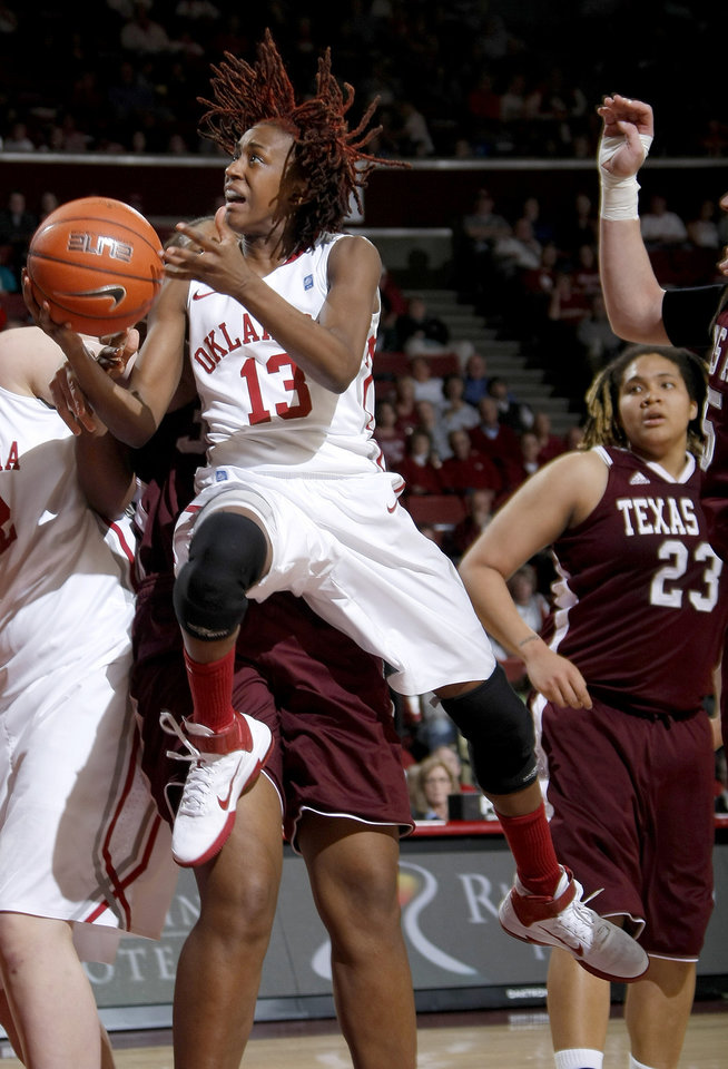 Photo - OU's Danielle Robinson (13)goes past Texas A&M's Karla Gilbert (34) and Texas A&M's Danielle Adams (23) during the Big 12 women's basketball game between the University of Oklahoma and Texas A&M at Lloyd Noble Center in Norman, Okla., Wednesday January 26, 2011.  Photo by Bryan Terry, The Oklahoman