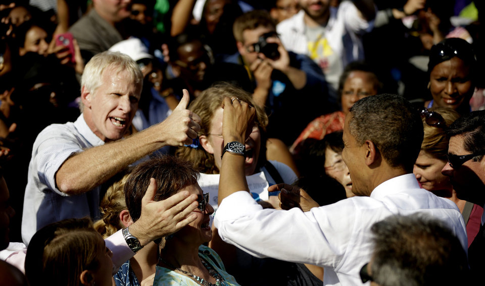 Photo -   An unidentified supporter gives President Barack Obama a 'thumbs-up' at a campaign event at the Carillon at Byrd Park, Thursday, Oct. 25, 2012, in Richmond Va. The president is on the second day of his 48 hour, 8 State campaign blitz. (AP Photo/Pablo Martinez Monsivais)
