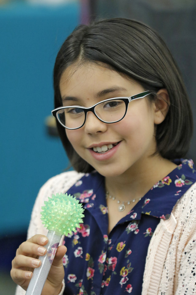 Photo -  Lucia Corredor, a fifth-grade student at Heritage Elementary School in Edmond, talks with her classmates in Linda Skinner's enrichment class. [Photo By Steve Gooch, The Oklahoman]