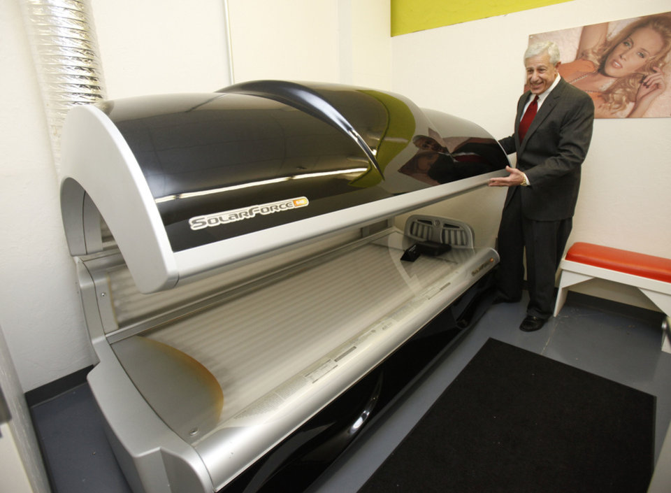 Louis Dakil shows one of the high-end tanning beds being auctioned next week at the Tan & Tone America at 11720 S Western in Oklahoma City, OK, Tuesday, January 22, 2013,  By Paul Hellstern, The Oklahoman