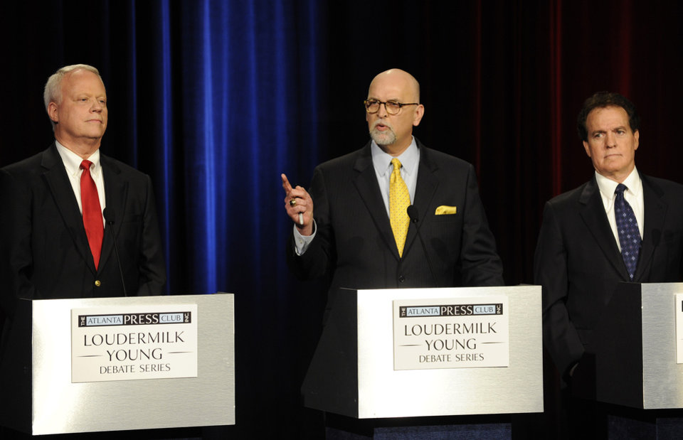 Photo - Republican Senatorial candidates, from left to right, Rep. Paul Broun of Athens, Ga., Art Gardner, a patent lawyer, and Rep. Phil Gingery of Marietta, Ga., participate in a debate at the Georgia Public Broadcasting studio, Sunday, May 11, 2014, in Atlanta. (AP Photo/David Tulis)