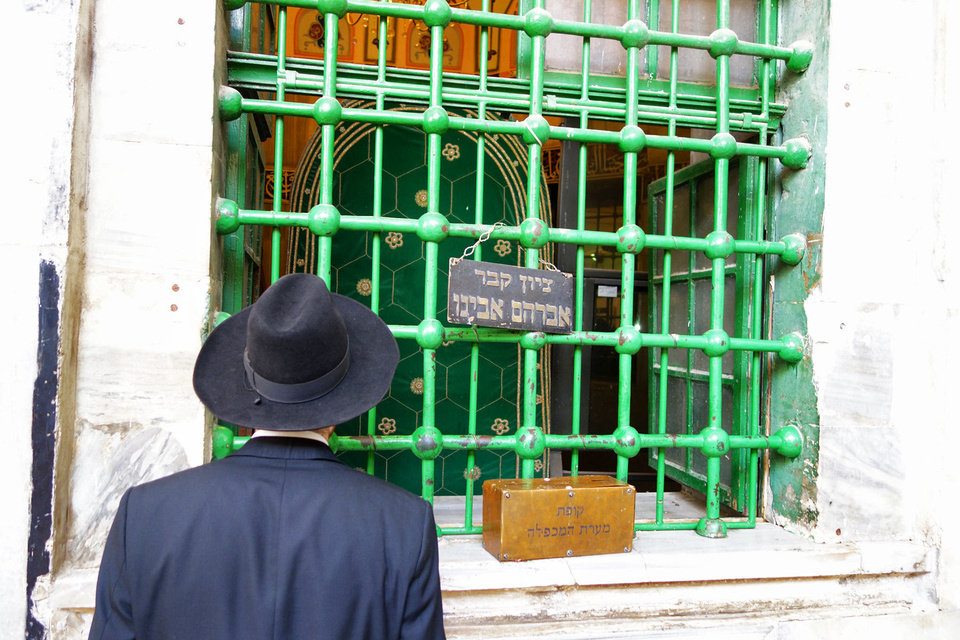 Photo - This worshiper has a view of Abraham's burial site from the Jewish side of the Tomb of the Patriarchs. Photo by Rick Steves/Rick Steves? Europe