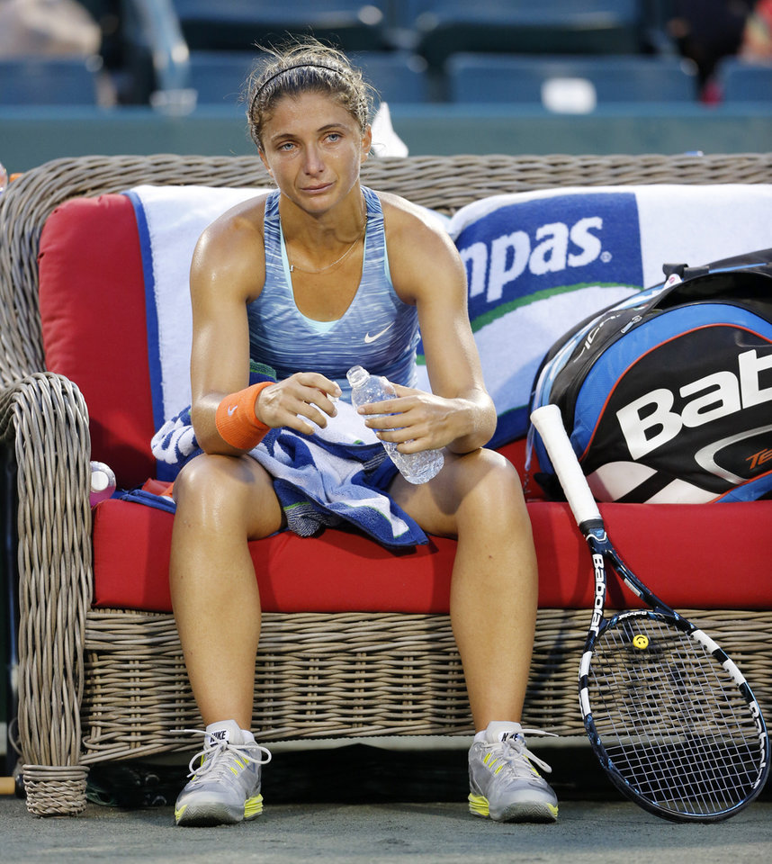 Photo - Sara Errani, of Italy, shows the exhaustion of playing three sets against Belinda Bencic, of Switzerland, during the Family Circle Cup tennis tournament in Charleston, S.C., Friday, April 4, 2014. (AP Photo/Mic Smith)