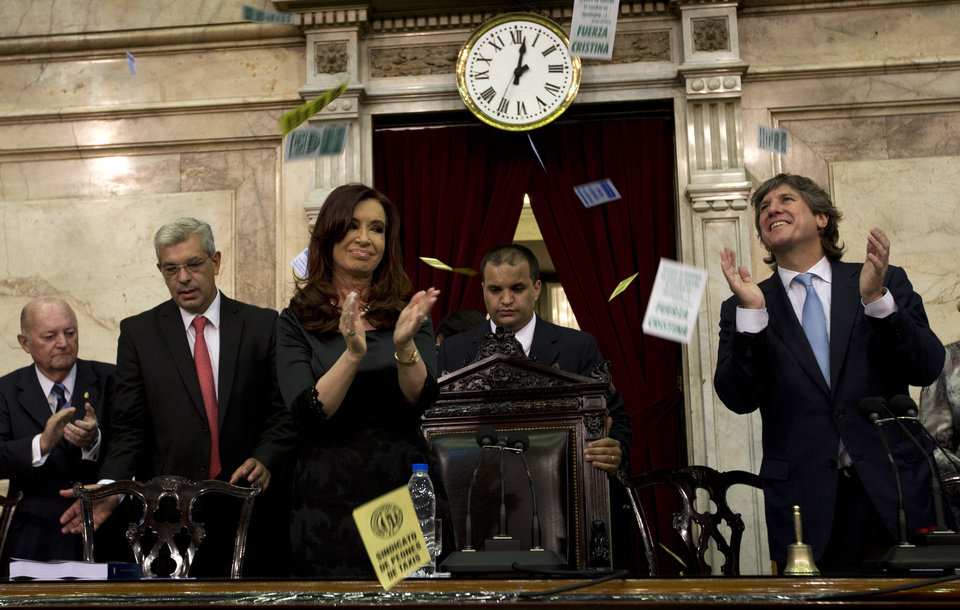 Argentina's President Cristina Fernandez and Vice President Amado Boudou, right, clap as supporters sing, not pictured, after Fernandez entered the chamber of the Argentine National Congress in Buenos Aires, Argentina, Friday, March 1, 2013. Fernandez was on hand to inaugurate the 2013 legislative year. (AP Photo/Victor R. Caivano)
