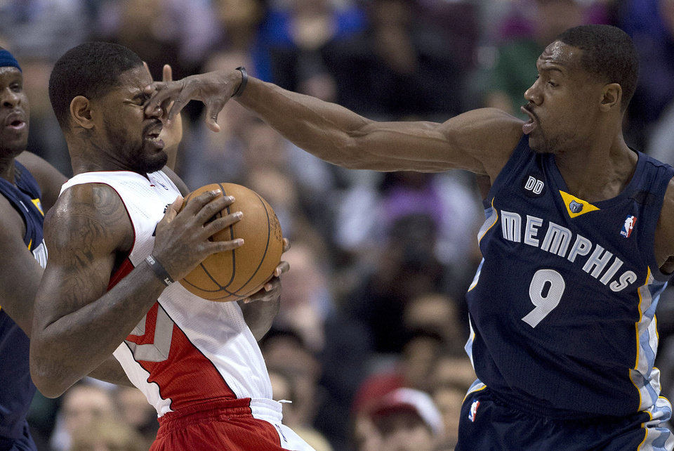 Memphis Grizzlies guard Tony Allen (9) pokes Toronto Raptors forward Amir Johnson in the face during the first half of an NBA basketball game in Toronto on Wednesday, Feb. 20, 2013. (AP Photo/The Canadian Press, Frank Gunn)