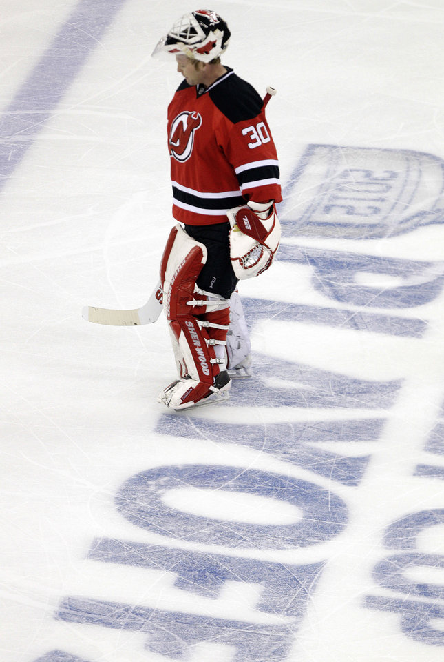 Photo -   New Jersey Devils' Martin Brodeur skates during a breack in the third period of game 3 of an NHL hockey Stanley Cup Eastern Conference final playoff series against the New York Rangers, Saturday, May 19, 2012, in Newark, N.J. (AP Photo/Frank Franklin II)
