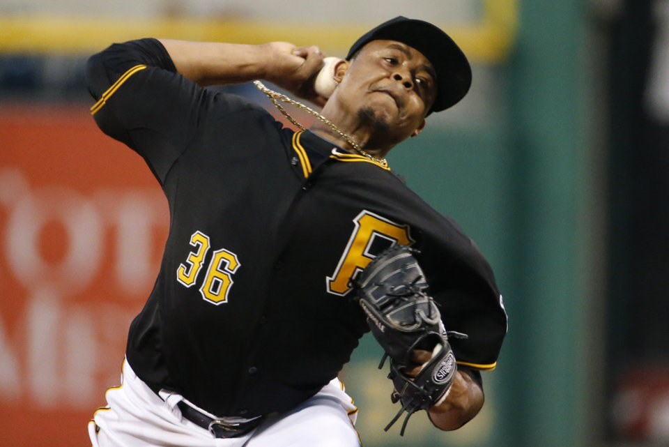 Photo - Pittsburgh Pirates starting pitcher Edinson Volquez delivers during the third  inning of a baseball game against the St. Louis Cardinals in Pittsburgh, Saturday, May 10, 2014. (AP Photo/Gene J. Puskar)