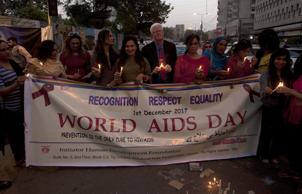 Photo - Pakistani transgenders holds candles while attending a demonstration called by civil society group to mark World AIDS Day in Karachi, Pakistan, Thursday, Dec. 1, 2016. (AP Photo/Shakil Adil)