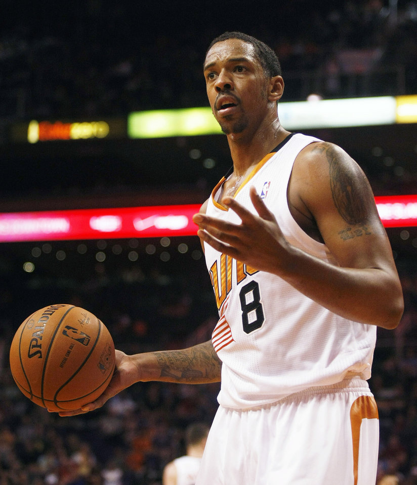 Photo - Phoenix Suns forward Channing Frye (8) reacts to a foul call in the first quarter of an NBA basketball game against the Houston Rockets, Sunday, Feb. 23, 2014, in Phoenix. (AP Photo/Rick Scuteri)