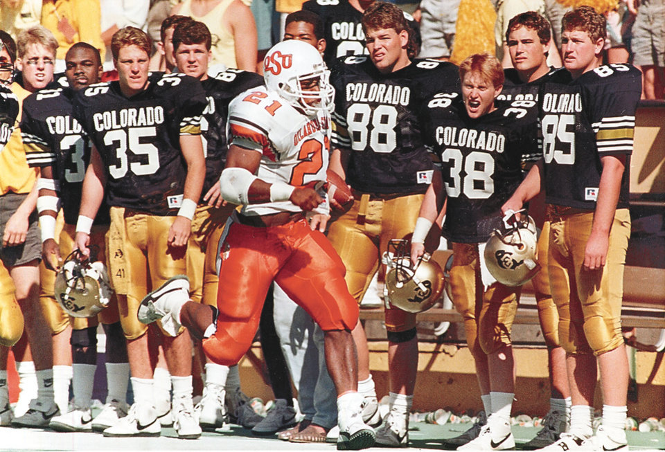 Photo - OSU's  Barry  Sanders, who won the 1988  Heisman Trophy and set the NCAA single-season rushing record. Staff Photo by Paul Hellstern (Original photo taken 10/08/88, ran 10/13/88)