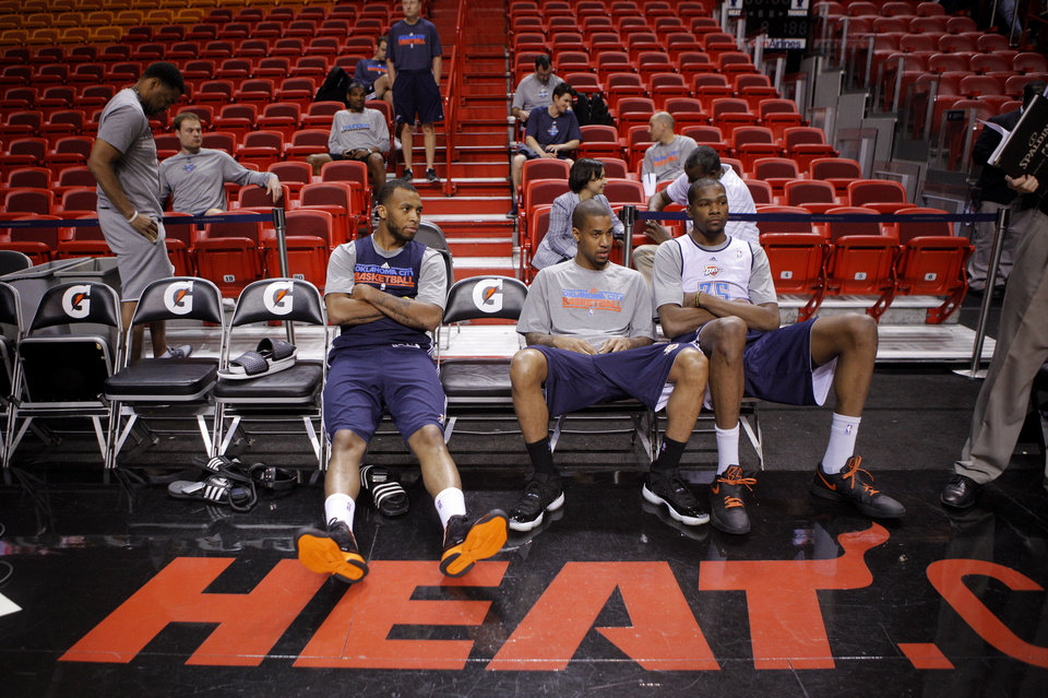 Photo - Oklahoma City's Daequan Cook, left, Eric Maynor, and Kevin Durant, talk during a practice for Game 5 of the NBA Finals between the Oklahoma City Thunder and the Miami Heat at American Airlines Arena, Wednesday, June 20, 2012. Photo by Bryan Terry, The Oklahoman