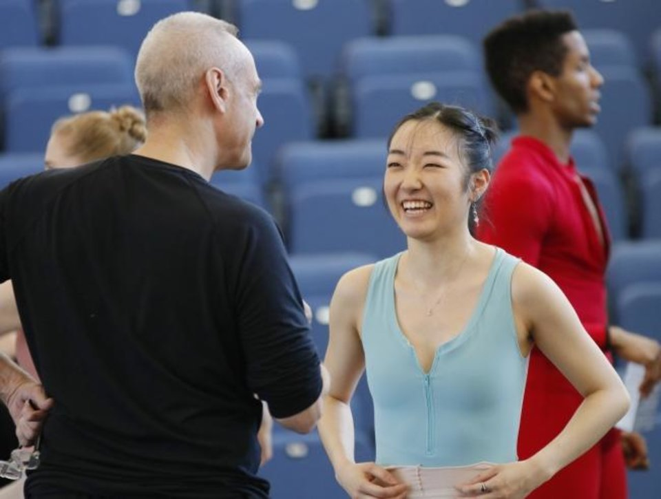 Photo -  Oklahoma City Ballet company dancer Mayu Odaka, right, speaks April 8 with Paul Boos, repetiteur with the George Balanchine Trust,   during rehearsals at the Susan E. Brackett Dance Center.  [Doug Hoke/The Oklahoman]