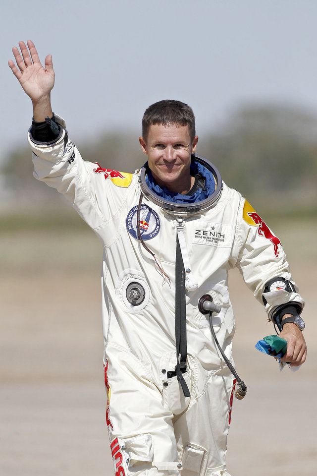 Felix Baumgartner, of Austria, waves to the crowd after successfully jumping from a space capsule lifted by a helium balloon at a height of just over 128,000 feet above the Earth\'s surface, Sunday, Oct. 14, 2012, in Roswell, N.M.(AP Photo/Ross D. Franklin) ORG XMIT: NMRF118