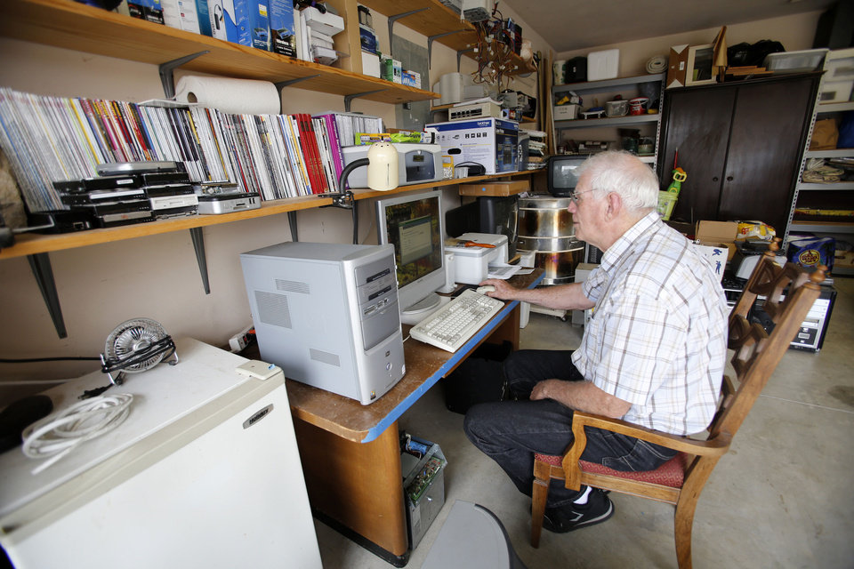 Dave Stewart works on a computer in his garage in Oklahoma City. Photo By Steve Gooch, The Oklahoman