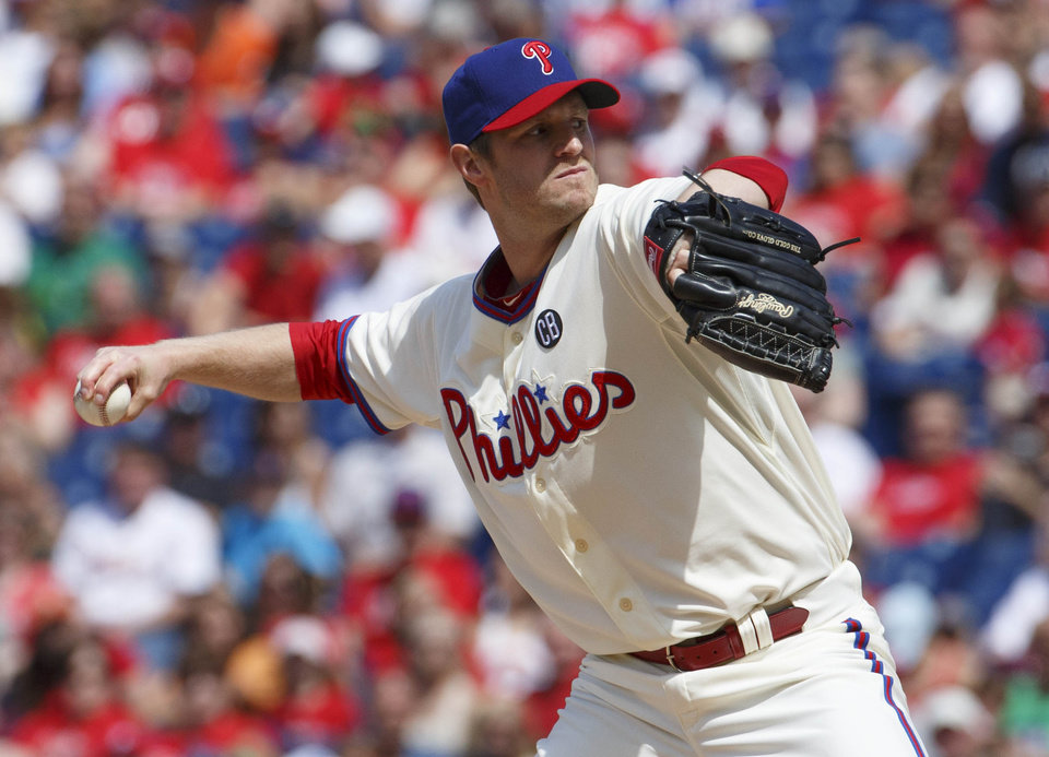 Photo - Philadelphia Phillies starting pitcher Kyle Kendrick pitches during the first inning of a baseball game against the New York Mets, Saturday, May 31, 2014, in Philadelphia. (AP Photo/Chris Szagola)