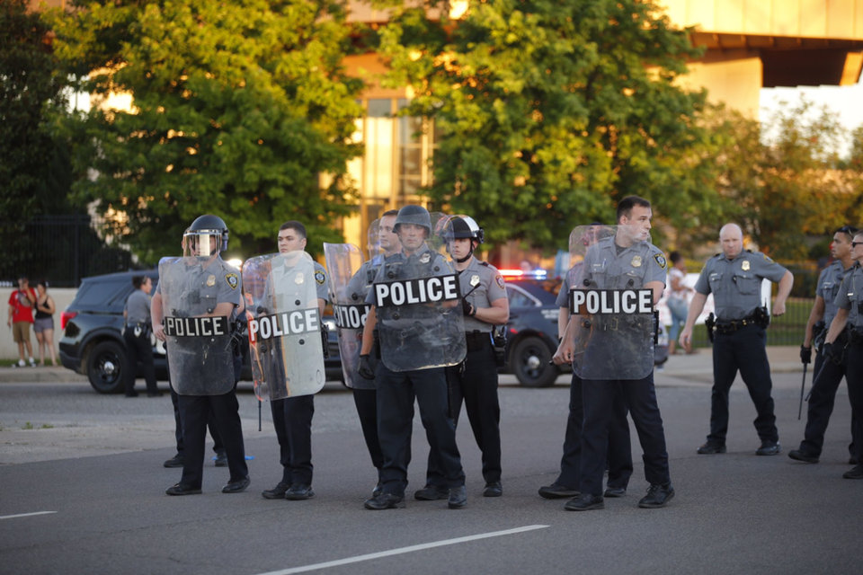 Photo - Oklahoma City Police gather to meet protesters Saturday, May 30, 2020, near NW 23rd and Classen in Oklahoma City. Photo by Sarah Phipps
